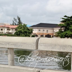 photograph of houses from bridge close to water real estate KORE 8