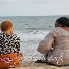 people at the beach sun KORE4