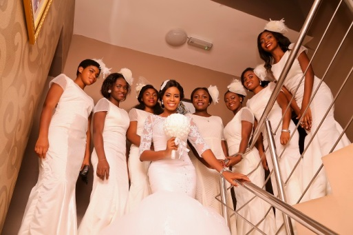 bride and bridesmaids in white dresses and white bouquet and white head hats IMG_1369