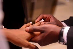 black couple fixing wedding ring into finger IMG_1722